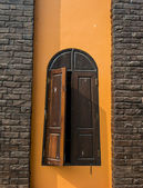 Wooden window on Orange wall — Stockfoto