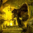 Stock Photo: Golden beautiful Buddhstatue in cave
