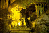 Golden beautiful Buddha statue in the cave — Stock Photo