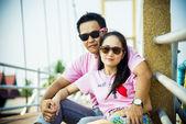Lovely couple sit on the bridge2 — Stock Photo