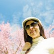 Smile lady with pink cherry flower and blue sky1 — Stock Photo #42617265