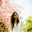 Smile woman with pink cherry flower tree2 — Stock Photo #42705809