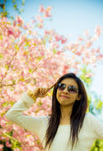 Smile woman with pink cherry flower tree5 — Стоковое фото