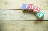 Wooden block word is GOAL on wooden background — Stock Photo