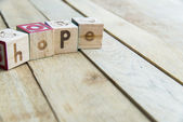 Wooden blocks are Hope word on wooden floor — Stock Photo