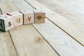 Wooden blocks are Save word on wooden floor — Stock Photo