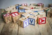 Variety wooden blocks on wooden floor1 — Stock Photo