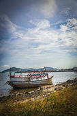 The sinked boat with fisherman village6 — Stock Photo