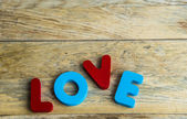 Colorful wooden word Love on wooden floor2 — Stock Photo