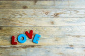 Colorful wooden word Love on wooden floor — Stock Photo