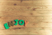 Mot en bois coloré profiter sur floor2 en bois — Photo