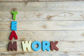 Colorful wooden word Teamwork on wooden floor2 — Stock Photo