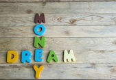 Colorful wooden word Dream and Money on wooden floor — Stock Photo