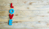 Colorful wooden word Love on wooden floor3 — Stock Photo