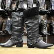 Black female leather boots — Stock Photo