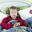 Stock Photo: Boy in bed with fever