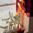 Christmas candles starting a fire — Stockfoto
