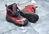 Winter shoes making a mess in the entrance — Stock Photo