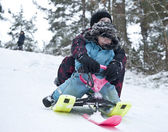 Downhill on a snow sledge — Stock Photo