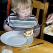 Young boy getting some more pancakes — Stock Photo #16901193