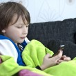 Boy sending text message — Stock Photo