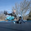 Springtime fun on a trampolin — Stock Photo