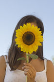 Valentina with a sunflower — Stock Photo