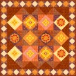 Brown patchwork quilt — Photo