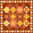 Brown patchwork quilt - Stock Photo