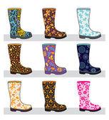 Conjunto de botas de goma de colores — Vector de stock
