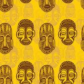 Pattern of tribal masks — Stock Vector