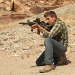 Stock Photo: Teenage boy shooting rifle.