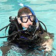 Boy wearing scuba diving equipment. - Stock Photo
