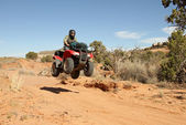 Teenage boy driving All Terrain Vehicle (ATV). — Stock Photo