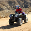 Woman driving a All Terrain Vehicle ( ATV). — Stock Photo