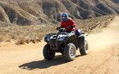 Woman driving a All Terrain Vehicle ( ATV). — Stock Photo