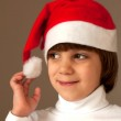 Girl touching her christmas cap — Stock Photo