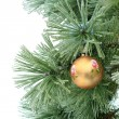 Stock Photo: Gold christmas ball on pine branch