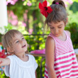 Two cute little sisters summer outdoor portrait — Stock Photo