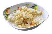 Homemade millet porridge with raisins isolated on white — Stock Photo