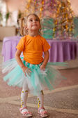 Pretty smiling little girl on christmas party — Stock Photo