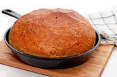 Homemade bread in frying pan — Stock Photo
