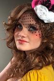 Beautiful girl wearing little hat — Stock Photo