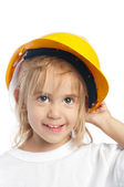 Little girl wearing yellow hard hat — Stock Photo