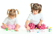 Two little girls painting (isolated on white background) — Stock Photo