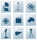 Icons with retro silhouettes of gramophone, reflector, film, cam — Stock Vector