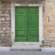 Green door of old mediterranean stone house in Croatia — Stock Photo