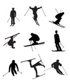 Skiing silhouettes on the white background — Stock Vector