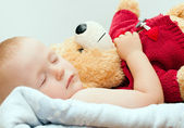 Sleeping baby with bear — Stock Photo
