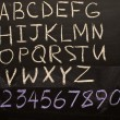 Alphabet and Numerals - Stockfoto